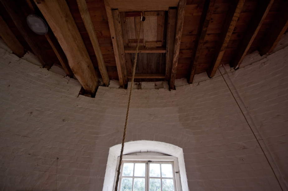 Trap doors prevent grain sack from falling back